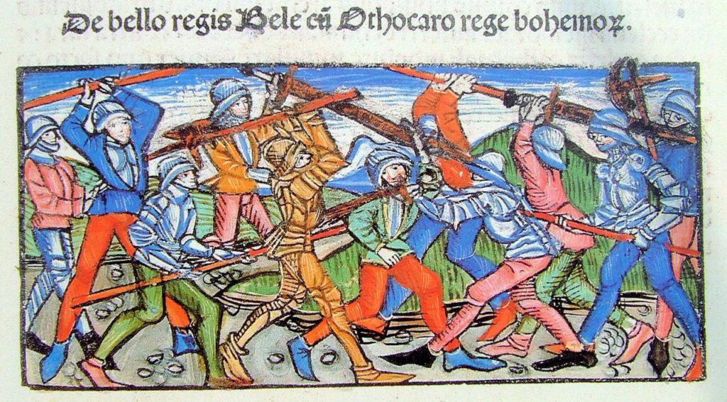 """Magyarok és bajorok a 13. században - II. rész. A kroissenbrunni csata. Thuróczi János: Chronica Hungarorum, 15. sz. (A kép forrása: <a href=""""https://hu.wikipedia.org/wiki/Kroissenbrunni_csata#/media/F%C3%A1jl:Battle_of_Kressenbrunn_Thur%C3%B3czy.JPG"""">Wikipédia</a>)"""